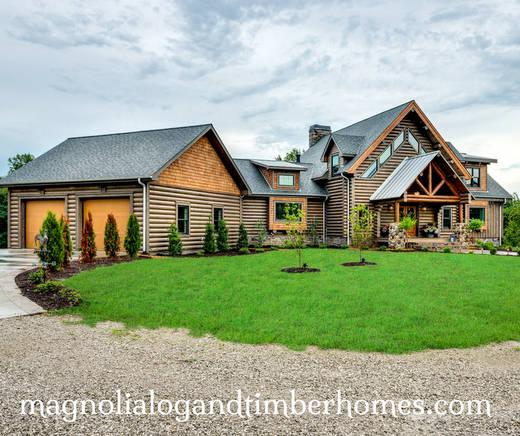 Log home with attached garage accessed through expansive mud room